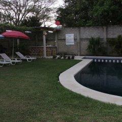 Отель BM Zihua Casa de Huéspedes бассейн