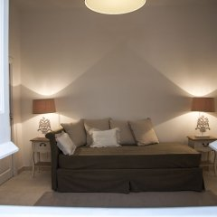 Апартаменты Santa Marta Suites & Apartments Лечче комната для гостей фото 5