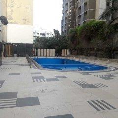 Отель Cambay Grand бассейн