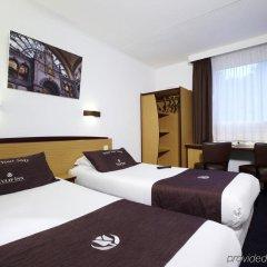 Отель Tulip Inn Antwerpen Антверпен сейф в номере