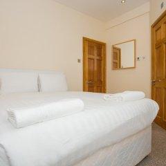 Отель 2 Bedroom Apartment In Fulham Великобритания, Лондон - отзывы, цены и фото номеров - забронировать отель 2 Bedroom Apartment In Fulham онлайн комната для гостей фото 4