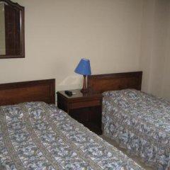 Отель Suites House Centenario Колумбия, Кали - отзывы, цены и фото номеров - забронировать отель Suites House Centenario онлайн комната для гостей фото 5