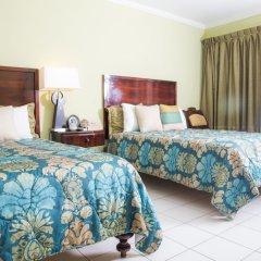 Отель The Cardiff Hotel & Spa Ямайка, Ранавей-Бей - отзывы, цены и фото номеров - забронировать отель The Cardiff Hotel & Spa онлайн комната для гостей фото 4
