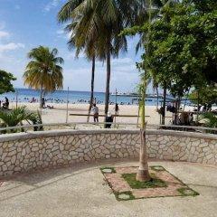 Отель Sand Getaway пляж фото 2