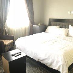 Отель Pentagon Luxury Suites Enugu Энугу комната для гостей