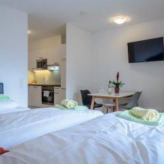 Апартаменты FeelGood Apartments Seestadt Green Living Вена комната для гостей фото 4