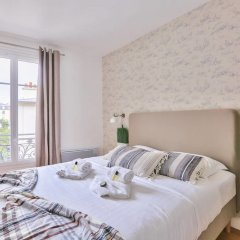 Апартаменты Family Apartment in Buttes Chaumont Париж комната для гостей