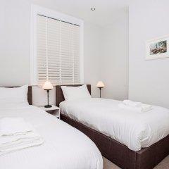 Отель Luxurious 4 Bedroom Flat by Baker Street Великобритания, Лондон - отзывы, цены и фото номеров - забронировать отель Luxurious 4 Bedroom Flat by Baker Street онлайн комната для гостей фото 4