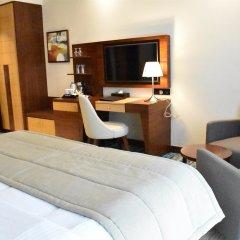 Отель Golden Tulip Al Thanyah удобства в номере