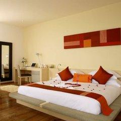 Отель IndoChine Resort & Villas сейф в номере фото 2