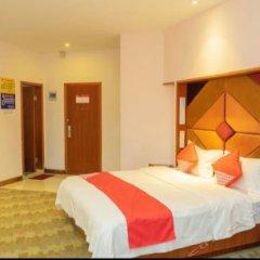 Yijia Business Hotel комната для гостей