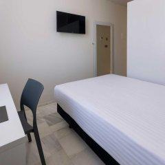 Отель SERHS Carlit Испания, Барселона - 4 отзыва об отеле, цены и фото номеров - забронировать отель SERHS Carlit онлайн комната для гостей фото 2