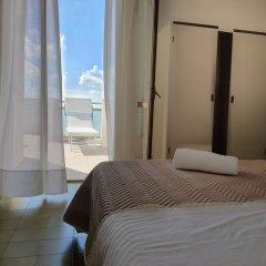 Отель Sorriso Италия, Нумана - отзывы, цены и фото номеров - забронировать отель Sorriso онлайн комната для гостей фото 3