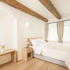 Отель U Bílé lilie Чехия, Прага - отзывы, цены и фото номеров - забронировать отель U Bílé lilie онлайн комната для гостей фото 2