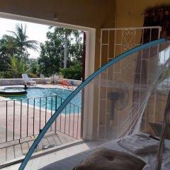 Отель A Piece of Paradise Montego Bay Ямайка, Монтего-Бей - отзывы, цены и фото номеров - забронировать отель A Piece of Paradise Montego Bay онлайн балкон