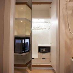 Отель Oxygen Lifestyle Helvetia Parco Римини сейф в номере