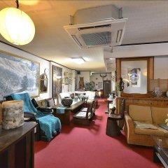 Отель Yumoto Miyoshi Япония, Беппу - отзывы, цены и фото номеров - забронировать отель Yumoto Miyoshi онлайн интерьер отеля