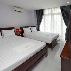 Cozy Hotel комната для гостей