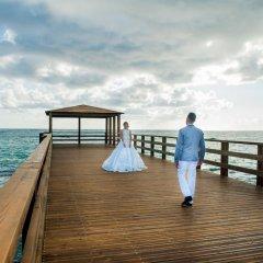 Отель Impressive Premium Resort & Spa Punta Cana – All Inclusive Доминикана, Пунта Кана - отзывы, цены и фото номеров - забронировать отель Impressive Premium Resort & Spa Punta Cana – All Inclusive онлайн приотельная территория фото 2