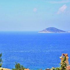 Villa Rimma by Akdenizvillam Турция, Калкан - отзывы, цены и фото номеров - забронировать отель Villa Rimma by Akdenizvillam онлайн пляж