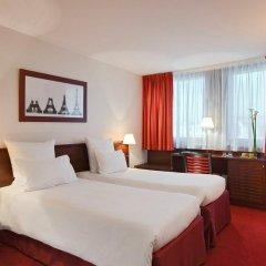 Отель Hôtel Concorde Montparnasse 4* Улучшенный номер с различными типами кроватей фото 11