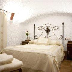 Отель Cuevalia. Alojamiento Rural En Cueva Сьерра-Невада комната для гостей фото 4