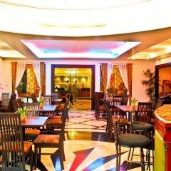 Отель Oxford Suites Makati Филиппины, Макати - отзывы, цены и фото номеров - забронировать отель Oxford Suites Makati онлайн питание фото 3
