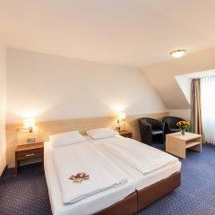 Отель Novum Hotel Mariella Airport Германия, Кёльн - 1 отзыв об отеле, цены и фото номеров - забронировать отель Novum Hotel Mariella Airport онлайн комната для гостей фото 5