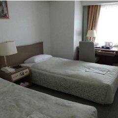 Отель Princess Garden Япония, Токио - отзывы, цены и фото номеров - забронировать отель Princess Garden онлайн удобства в номере фото 2
