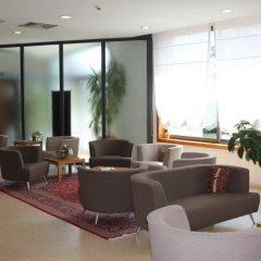 Отель MH Hotel Piacenza Fiera Италия, Пьяченца - отзывы, цены и фото номеров - забронировать отель MH Hotel Piacenza Fiera онлайн интерьер отеля фото 2