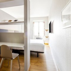 Отель San Miguel Suites комната для гостей