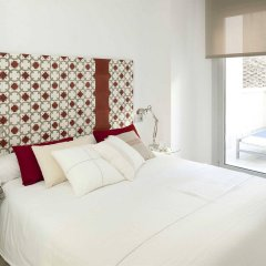 Отель Eric Vökel Boutique Apartments - Atocha Suites Испания, Мадрид - отзывы, цены и фото номеров - забронировать отель Eric Vökel Boutique Apartments - Atocha Suites онлайн комната для гостей