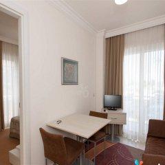 Kamer Suites & Hotel Чешме комната для гостей фото 5