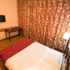 Отель Tagaitai Guest House Кыргызстан, Каракол - отзывы, цены и фото номеров - забронировать отель Tagaitai Guest House онлайн удобства в номере фото 2