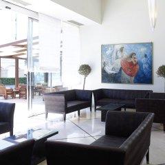 Mitsis La Vita Beach Hotel интерьер отеля
