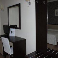 Hotel Hermitage Куальяно сейф в номере
