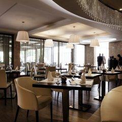Отель Pullman Kinshasa Grand Hotel Республика Конго, Киншаса - отзывы, цены и фото номеров - забронировать отель Pullman Kinshasa Grand Hotel онлайн питание