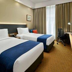 Отель Holiday Inn Express Singapore Orchard Road Сингапур комната для гостей фото 4