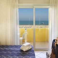 Отель Piccadilly Appartamenti Римини комната для гостей фото 5