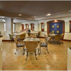 Отель The LaLiT Golf & Spa Resort Goa питание фото 2