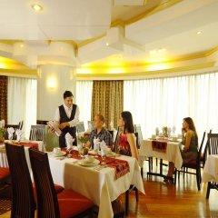 Отель Oxford Suites Makati Филиппины, Макати - отзывы, цены и фото номеров - забронировать отель Oxford Suites Makati онлайн питание