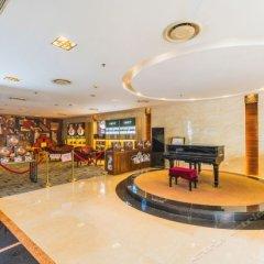 Отель Zhongshan Sunshine Business Hotel Китай, Чжуншань - отзывы, цены и фото номеров - забронировать отель Zhongshan Sunshine Business Hotel онлайн гостиничный бар
