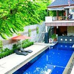 Отель Surintra Boutique Resort бассейн