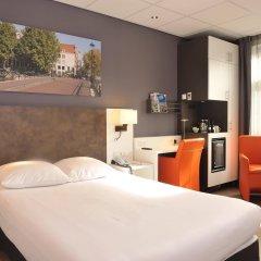 Отель Amsterdam - De Roode Leeuw Нидерланды, Амстердам - 1 отзыв об отеле, цены и фото номеров - забронировать отель Amsterdam - De Roode Leeuw онлайн комната для гостей