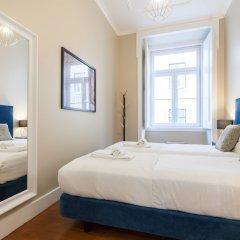 Апартаменты Baixa Vintage Three-Bedroom Apartment - by LU Holidays Лиссабон комната для гостей фото 2