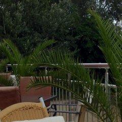 TM Deluxe Hotel балкон