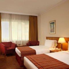 Отель Swiss-Belhotel Sharjah комната для гостей фото 6