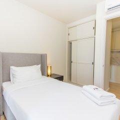 Отель Dlux Condominium Таиланд, Бухта Чалонг - отзывы, цены и фото номеров - забронировать отель Dlux Condominium онлайн комната для гостей фото 4