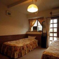 Отель Pension Akanegumo Минамиогуни комната для гостей