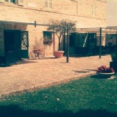 Отель San Claudio Корридония бассейн